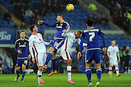Cardiff City's Anthony Pilkington (13) beats the M K Dons defenders to a header. Skybet football league championship match, Cardiff city v MK Dons at the Cardiff city stadium in Cardiff, South Wales on Saturday 6th February 2016.<br /> pic by Carl Robertson, Andrew Orchard sports photography.