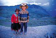 Two young Inca herders smile shyly at the camera before disappearing down the mountainside to tend their llamas and sheep in the high mountain passes above the city of Cuzco on the southern slopes of the Andes. (Man Eating Bugs page 150,151)