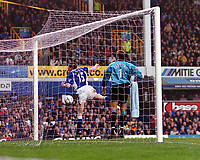 Fredrik Ljungberg's shot hits the under side of the bar but bounces out as Everton's Gary Naysmith and Paul Gerrard can only look on. Everton v Arsenal. 18/11/2000.FA Premiership. Credit: Andrew Cowie / Colorsport.