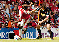 Photo: Leigh Quinnell.<br /> Bristol City v Rotherham United. Coca Cola League 1. 05/05/2007. Bristol Citys Enoch Showunmi turns from Rotherhams Ian Sharps.