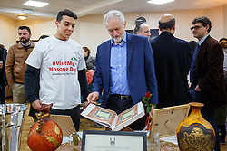 © Licensed to London News Pictures. 05/02/2017. London, UK. Labour leader JEREMY CORBYN looks at a copy of Quran at Finsbury Park Mosque in North London during his visit to the mosque on an open day. On Visit My Mosque Day over 150 mosques around the UK open their doors to the public, offering a better understanding of religion in effort to counter rising Islamophobia.  Photo credit: Tolga Akmen/LNP