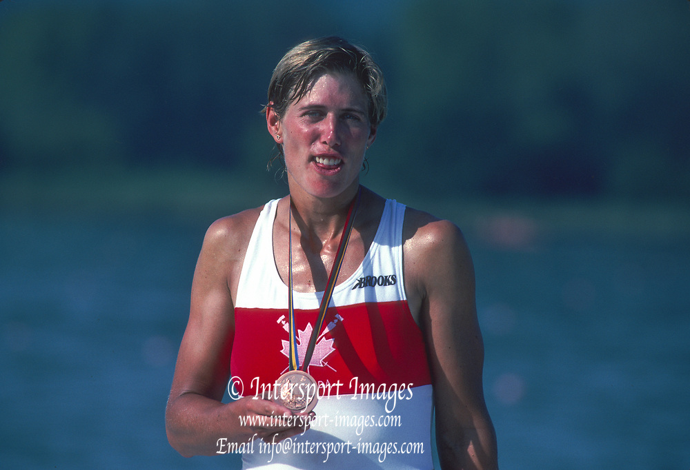 Barcelona Olympic Games 1992<br /> Olympic Regatta - Lake Banyoles<br /> CAN W1X. Silken Laumann on awards dock.; With Bandaged Leg, after a collision with another boat at an earlier European Regatta, {Mandatory Credit: © Peter Spurrier/Intersport Images]