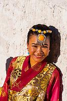 Chinese woman in traditional dress, near the Potala Palace, Lhasa (Xizang), TIbet (China).