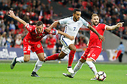 England Midfielder Theo Walcott gets passed Malta Defender Alex Muscat and Malta Midfielder Paul Fenech during the FIFA World Cup Qualifier match between England and Malta at Wembley Stadium, London, England on 8 October 2016. Photo by Andy Walter.