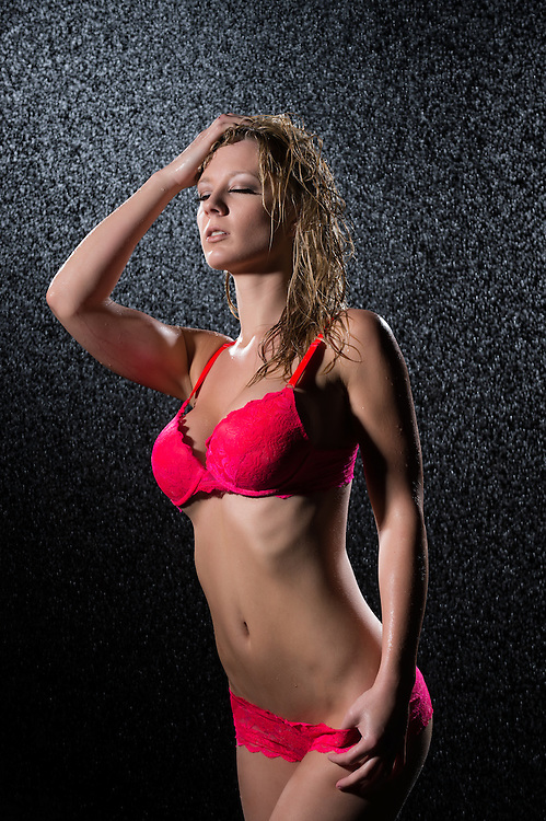 Seductive wet woman in red bra and underwear
