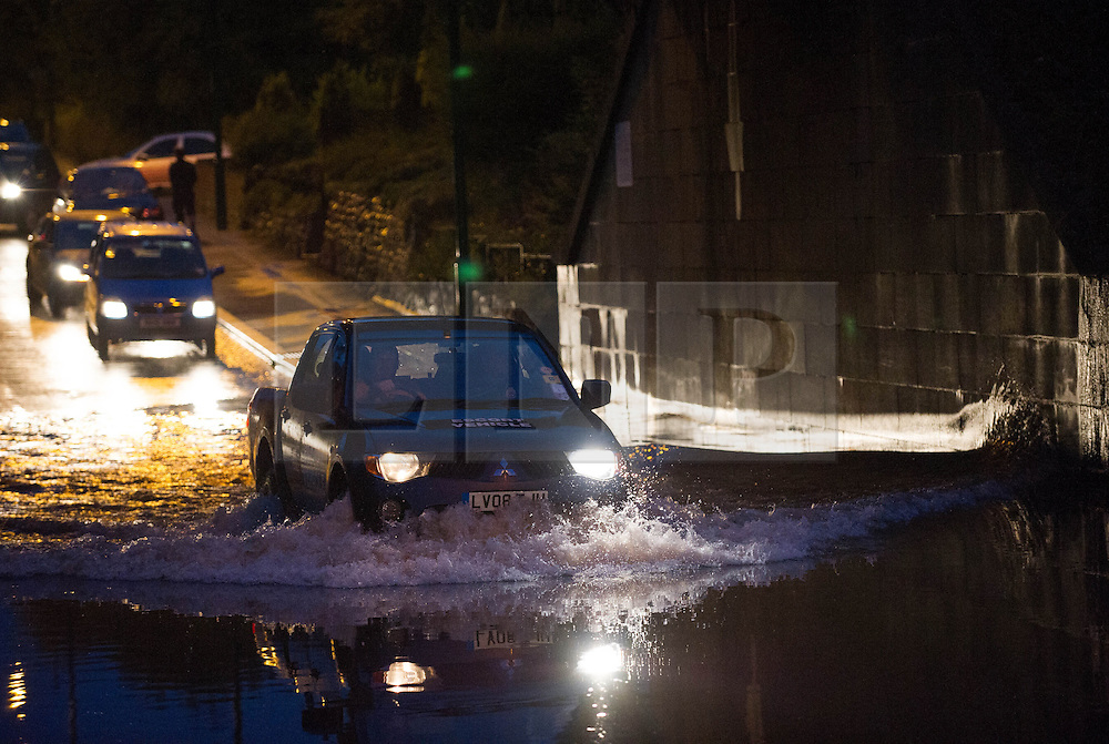 © Licensed to London News Pictures. 06/09/2013<br /> <br /> Saltburn, Cleveland, England<br /> <br /> A car drives through flood water as heavy flooding hits in Saltburn in Cleveland causing the A174 road to be blocked due to the floods.<br /> <br /> Photo credit : Ian Forsyth/LNP