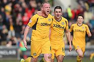 Newport's Lee Minshull (left) celebrates after scoring  his side's first goal. Skybet football league 2 match, Newport county v Scunthorpe Utd at Rodney Parade in Newport, South Wales on Saturday 1st March 2014.<br /> pic by Mark Hawkins, Andrew Orchard sports photography.