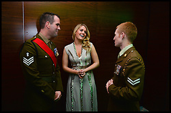 Earl Spencer's daughter Lady Kitty Spencer the Niece of Princess Diana talks to 2 soldiers from 11 EOD regiment after their tour in Afghanistan as she  attends Give Us Time event in London, United Kingdom. Wednesday, 27th November 2013. Give us Time is a charity set up for service personnel to have holidays with their families after tours in War zones. Picture by Andrew Parsons / i-Images