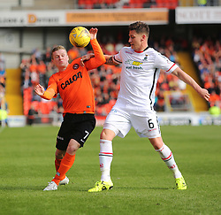 Dundee United's Billy McKay and Inverness Caledonian Thistle's Josh Meekings. <br /> Dundee United 1 v 1 Inverness Caledonian Thistle, SPFL Ladbrokes Premiership game played 19/9/2015 at Tannadice.