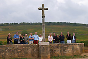 vineyard the stone cross group of visitors la romanee conti la romanee in back vosne-romanee cote de nuits burgundy france