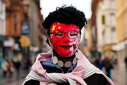 Glasgow, Scotland, UK. 19 January, 2020. Hong Kong students and Amnesty International stage a pro-democracy protest on Sauchiehall Street in Glasgow city centre. The protest was one of several in cities worldwide to protest against the anti-democratic policies of the Chinese Communist Party. Pictured, Caricature of Hong Hong Chief Executive Carrie Lam. Iain Masterton/Alamy Live News.