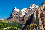 The Eiger (left) & Jungfrau (Right) from Murren - Alps Switzerland .<br /> <br /> Visit our SWITZERLAND  & ALPS PHOTO COLLECTIONS for more  photos  to browse of  download or buy as prints https://funkystock.photoshelter.com/gallery-collection/Pictures-Images-of-Switzerland-Photos-of-Swiss-Alps-Landmark-Sites/C0000DPgRJMSrQ3U