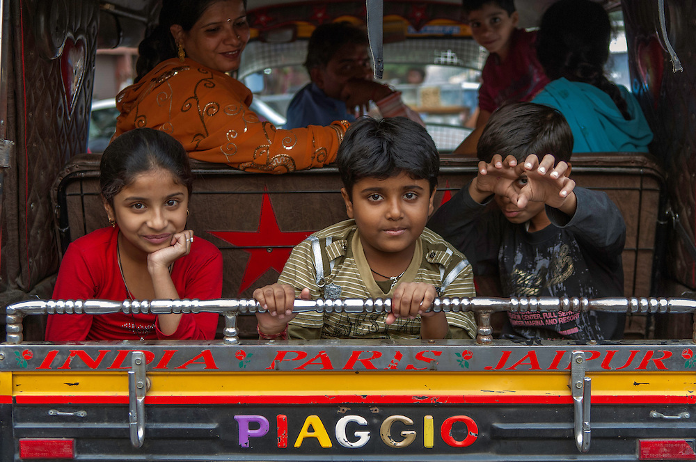 Children riding in the back of a Piaggio three wheeler, Jaipur