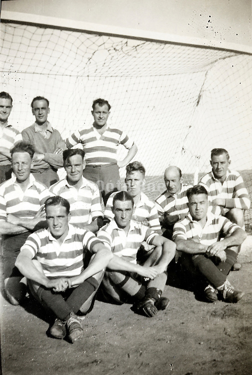 sports team posing by the the goal England 1940s
