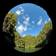 Fisheye shot of a lonely bay surrounded by tropical jungle