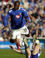 Fotball<br /> Premier League 2004/05<br /> Portsmouth v Everton<br /> 26. september 2004<br /> Foto: Digitalsport<br /> NORWAY ONLY<br /> Yakubu takes to the air after a challenge from Lee Carsley