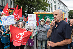Bill Parry, Unite delegate and construction worker, addresses Unite the union members protesting outside the Euston construction site for the HS2 high-speed rail link regarding trade union access to construction workers building tunnel sections for the project on 6th August 2021 in London, United Kingdom. Unite claims that HS2's joint venture contractor SCS, formed by Skanska, Costain and Strabag, has been hindering 'meaningful' trade union access to HS2 construction workers in contravention of the HS2 agreement.