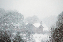 © Licensed to London News Pictures. 10/12/2017. Loggerheads UK. Houses can hardly be seen through the heavy snow in the village of Almington this morning as heavy snow begins falling in Shropshire. Photo credit: Andrew McCaren/LNP