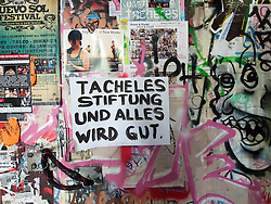 Sign on wall at Tacheles Kunsthaus or Art Gallery alternative collective on Oranienburger strasse in Mitte Berlin Germany