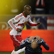Bradley Wright-Phillips, New York Red Bulls, celebrates after scoring the first of his two goals as Aurélien Collin, Sporting Kansas City, reacts in despair during the New York Red Bulls V Sporting Kansas City, Major League Soccer Play Off Match at Red Bull Arena, Harrison, New Jersey. USA. 30th October 2014. Photo Tim Clayton