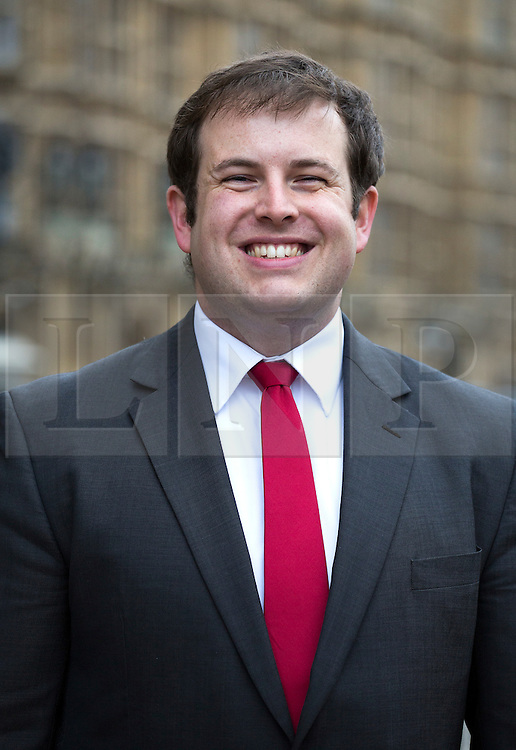 © licensed to London News Pictures. London, UK. FILE PIC DATED 19/11/2012. MP STEPHEN DOUGHTY, who has resigned as a shadow foreign minister, posing outside the House of Commons following a by-election victory. Photo credit: Tolga Akmen/LNP