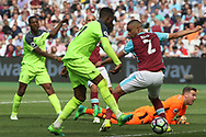 Divock Origi of Liverpool scores his teams fourth goal. Premier league match, West Ham Utd v Liverpool at the London Stadium, Queen Elizabeth Olympic Park in London on Sunday 14th May 2017.<br /> pic by Steffan Bowen, Andrew Orchard sports photography.