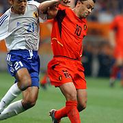 Belgium's Johan Walem holds off Japan's Kazuyuki Toda