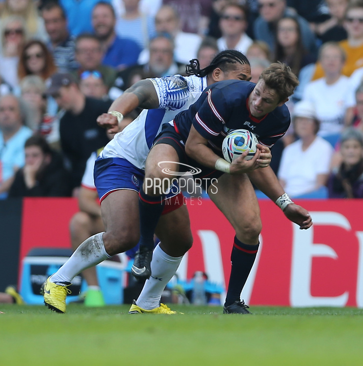 USA Blaine Scully shields the ball during the Rugby World Cup 2015 match between Samoa and USA at the Brighton Community Stadium, Falmer, United Kingdom on 20 September 2015.