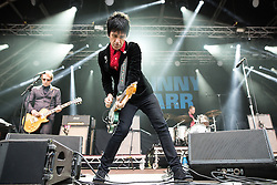 © Licensed to London News Pictures . 11/07/2015 . Manchester , UK . Johnny Marr performs . Summer in the City , live music as part of the Manchester International Festival , at the Castlefield Arena in Manchester . Photo credit : Joel Goodman/LNP