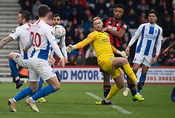 Brighton & Hove Albion's goalkeeper Jason Steele survives a goalmouth scramble