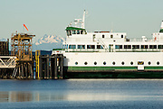 The Nisqually is one of the Washington State Ferries which cruise Puget Sound (part of the Salish Sea). Three Fingers Mountain rises 50 miles away in the Central Cascades.