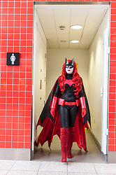 © Licensed to London News Pictures. 20/02/2016. London, UK. A girl dressed as Batwoman is amongst the fans gathered at the London Super Comic Convention at the Excel Centre in Docklands.  Many have dressed in homemade costumes which have taken hours to make with great attention to detail.<br />  Photo credit : Stephen Chung/LNP