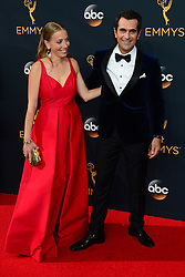 September 18, 2016 - Los Angeles, California, United States - Ty Burrell (R) and Holly Burrell arrives at the 68th Annual Emmy Awards at the Microsoft Theater in Los Angeles, California on Sunday, September 18, 2016. (Credit Image: © Michael Owen Baker/Los Angeles Daily News via ZUMA Wire)