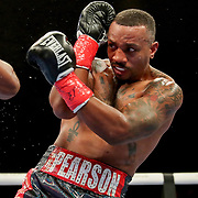 HOLLYWOOD, FL - APRIL 17: Christopher Pearson blocks a punch from Carlos Gongora during the IBO World Super Middleweight title fight at Seminole Hard Rock Hotel & Casino on April 17, 2021 in Hollywood, Florida. (Photo by Alex Menendez/Getty Images) *** Local Caption *** Carlos Gongora; Christopher Pearson