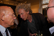 Sir Stirling Moss and Tony Dron. An exhibition of photos from the Maserati Archives. Michael Hoppen Gallery. 13 July 2005. ONE TIME USE ONLY - DO NOT ARCHIVE  © Copyright Photograph by Dafydd Jones 66 Stockwell Park Rd. London SW9 0DA Tel 020 7733 0108 www.dafjones.com