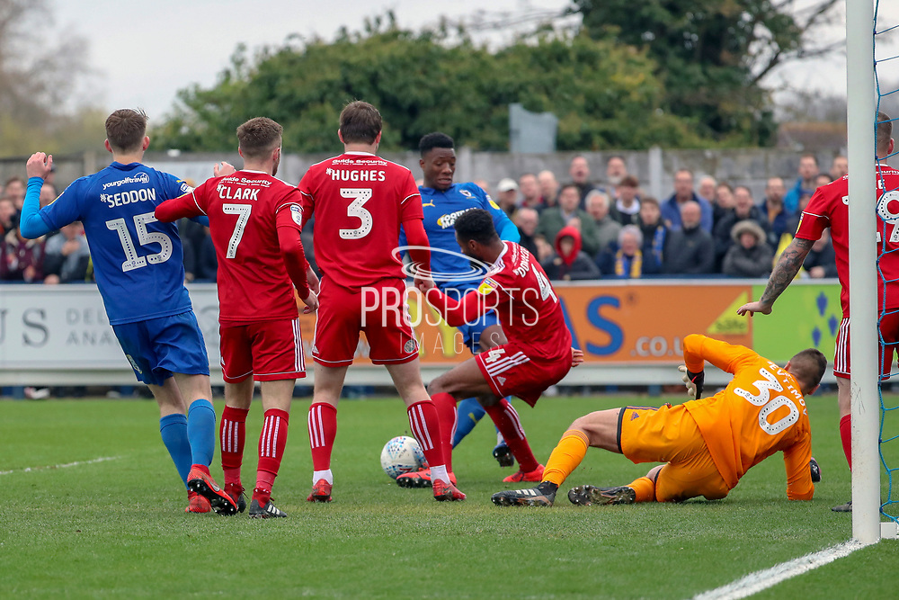 Scramble in the Accrington Stanley box during the EFL Sky Bet League 1 match between AFC Wimbledon and Accrington Stanley at the Cherry Red Records Stadium, Kingston, England on 6 April 2019.