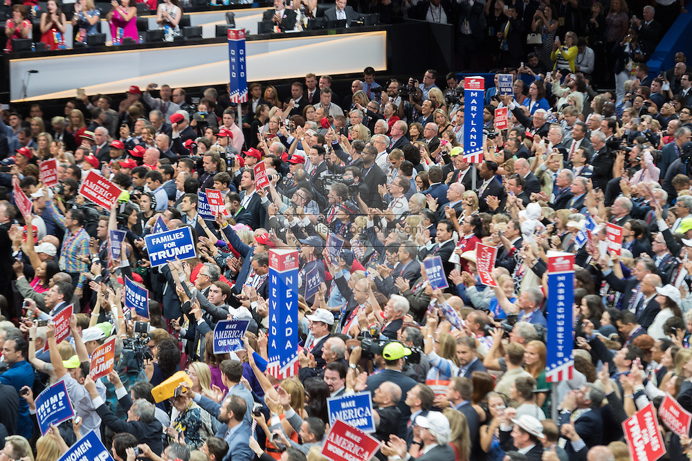 GOP delegates cheer Presidential candidate Donald Trump as he accepts the party nomination for president on the final day of the Republican National Convention July 21, 2016 in Cleveland, Ohio.