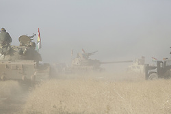 20/10/2016. Bashiqa, Iraq. A peshmerga T-55 tank points its gun toward Islamic State held positions as Kurdish forces carry out an operation to retake the ISIS held town of Bashiqa, Iraq, today (20/10/2016).<br /> <br /> Launched in the early hours of today with support from coalition special forces and air strikes, the attack is part of the larger operation to retake Mosul from the Islamic State, and involves both the Kurds and the Iraqi Army. The city of Bashiqa, around 9 miles north of Mosul, is one of several gateway areas that must be taken before any attempted offensive on Mosul itself.<br /> <br /> Despite the peshmerga suffering several casualties after militants fought back using mortars, heavy machine guns and snipers, the Kurdish forces were quickly taking ground with Haider al-Abadi, the Iraqi prime minister, stating that the operation to retake Mosul was progressing faster than expected. Photo credit: Matt Cetti-Roberts/LNP