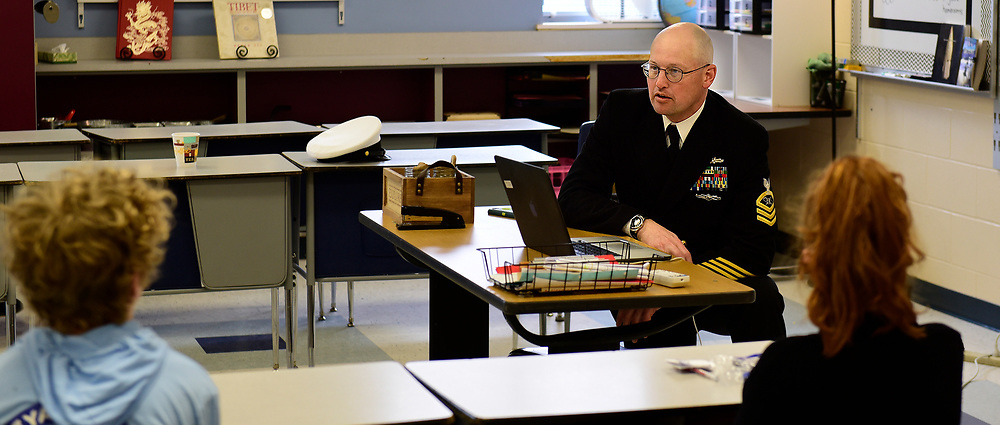 YARMOUTH, MAINE-- U.S. Navy Chief Mass Communication Specialist Roger Duncan of Yarmouth, Maine speaks to a career day class at Harrison Middle School in Yarmouth about being in the Navy Reserve and doing his kind of work: photography and writing. More than 20 volunteers visited the school to share their professional expertise with students. Duncan also runs a photography business as a civilian. See his work at http://www.rogerduncanphoto.com.  Photo courtesy of Harrison Middle School.