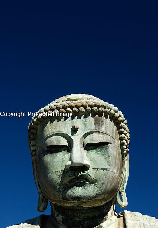 Detail of head of Buddha Statue at Kamakura in Japan