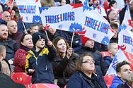 England fan waving flag during the UEFA Nations League match between England and Croatia at Wembley Stadium, London, England on 18 November 2018.