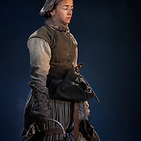"""Picture shows :  Jayd Johnson as Liza.<br /> Bondagers <br /> By Sue Glover<br /> Directed by Lu Kemp<br /> """"Redd up the stables, muck out the byre, plant the tatties, howk the tatties, clamp the tatties... Shear, stook, striddle, stack. Women's work.""""<br /> A true classic of modern Scottish Theatre, and a haunting evocation of a lost way of life, Sue Glover's lyrical play with music and song follows six women land workers as they graft and dance their way through a year on a 19th Century Borders farm.<br /> Every ploughman had to provide a woman (a bondager) to work on the farm. If his wife was too busy with family, he hired a woman to work the fields and lodge in his home. Following these womenthrough the passing of the seasons, we feel the rhythm of the land and the harshness, humour, hope and tragedy of those who worked upon it.<br /> Picture : Drew Farrell<br /> Tel : 07721 -735041<br /> www.drewfarrell.com<br /> <br /> <br /> For Further information please contact Michelle Mangan Press and PR Manager, Royal Lyceum Theatre Edinburgh <br /> Main Line: 0131 248 4800