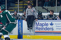 KELOWNA, CANADA - DECEMBER 30: Ward Pateman, linesman, jumps on the boards of the Everett Silvertips at the Kelowna Rockets on December 30, 2012 at Prospera Place in Kelowna, British Columbia, Canada (Photo by Marissa Baecker/Shoot the Breeze) *** Local Caption ***
