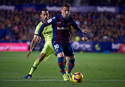 December 16, 2018 - Valencia, U.S. - VALENCIA, SPAIN - DECEMBER 16: Enis Bardhi, midfielder  of Levante UD competes for the ball with Sergio Busquets, midfielder of FC Barcelona during the La Liga match between Levante UD and FC Barcelona at Ciutat de Valencia on December 16, 2018 in Valencia, Spain. (Photo by Carlos Sanchez Martinez/Icon Sportswire) (Credit Image: © Carlos Sanchez Martinez/Icon SMI via ZUMA Press)