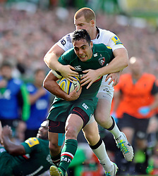 Leicester Tigers centre Dan Bowden is tackled in possession - Photo mandatory by-line: Patrick Khachfe/JMP - Tel: Mobile: 07966 386802 - 21/09/2013 - SPORT - RUGBY UNION - Welford Road Stadium - Leicester Tigers v Newcastle Falcons - Aviva Premiership.