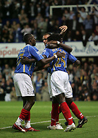 Photo: Lee Earle.<br /> Portsmouth v Manchester United. The FA Barclays Premiership. 15/08/2007.Portsmouth's Benjani is congratulated after scoring their first goal.