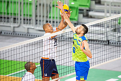 30-12-2019 SLO: Slovenia - Netherlands, Ljubljana<br /> Mitja Gasparini of Slovenia and Nimir Abdel-Aziz of the Netherlands during friendly volleyball match between National Men teams of Slovenia and Netherlands