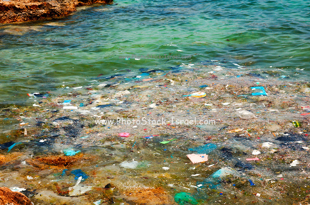 Waste, garbage and dirt floating in the Mediterranean Sea near the shore. Photographed in Cyprus, Agia Napa