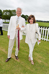 MICHAEL & PILAR BOXFORD at the Cartier Queen's Cup Final polo held at Guards Polo Club, Smith's Lawn, Windsor Great Park, Egham, Surrey on 15th June 2014.