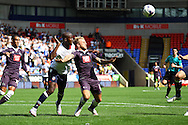 Johnny Russell of Derby County (r) and Prince Gouano of Bolton Wanderers battle for the ball. Skybet football league championship match, Bolton Wanderers v Derby County at the Macron stadium in Bolton, Lancs on Saturday 8th August 2015.<br /> pic by Chris Stading, Andrew Orchard sports photography.